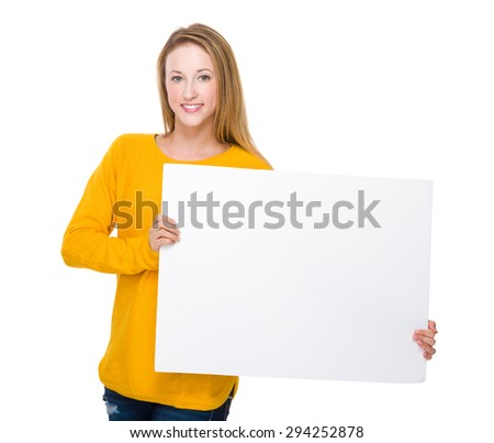Caucasian woman showing a white board - stock photo
