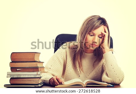 Caucasian woman tired because of studying - stock photo