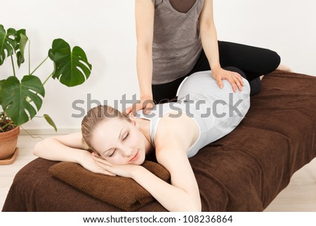 Caucasian woman undergoing a chiropractic - stock photo