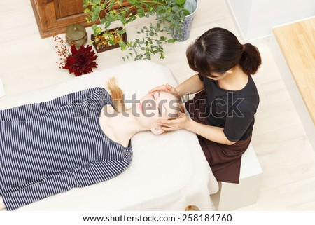 Caucasian woman undergoing a chiropractic