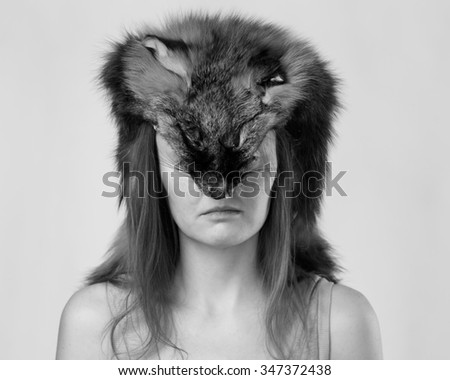 Caucasian woman with a fox skin on the head, isolated on a white background - stock photo