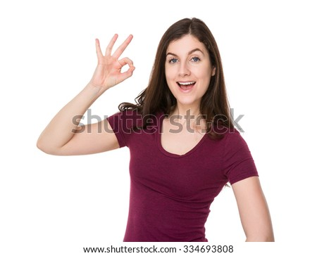 Caucasian woman with ok sign gesture - stock photo