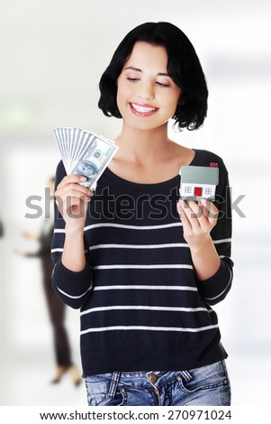 Caucasian woman with us dollar money and house.