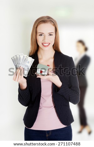 Caucasian woman with us dollar money and house. - stock photo