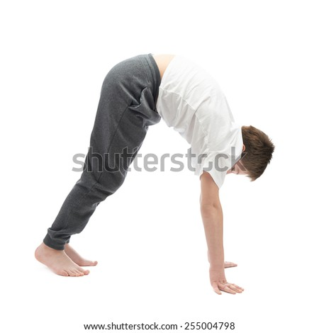 Caucasian 12 years old children boy in a white t-shirt stretching or doing yoga. Composition isolated over the white background - stock photo