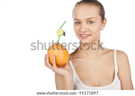 Caucasian young beautiful girl holding a juicy ripe grapefruit, charming smiles, isolated on white - stock photo
