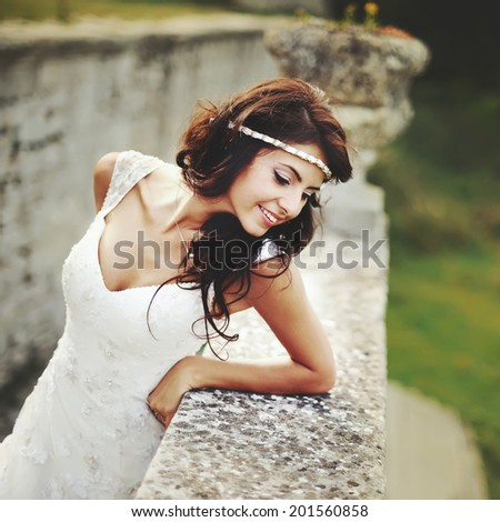 Caucasian young brunette bride outside. - stock photo