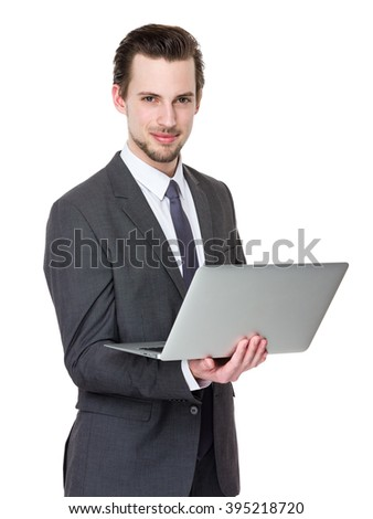 Caucasian young businessman use of notebook computer