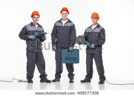 caucasian young different manual worker collection isolated on white with tools - stock photo