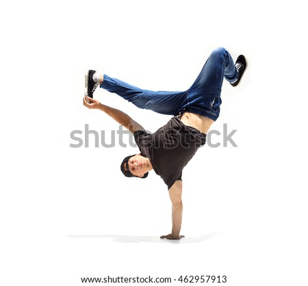 Caucasian young gay in jeans and hat dancing in conterporary style on the wwhite background