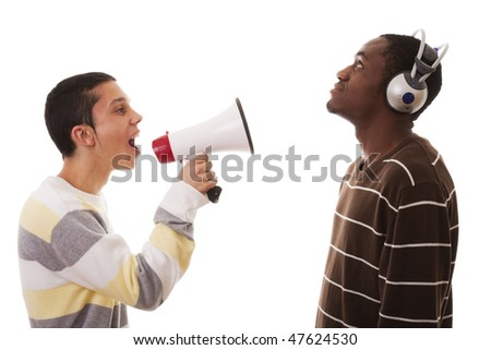 caucasian young man shouting to a african young man - stock photo