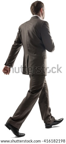 Caucasian young man with short dark hair in business formal outfit walking away isolated on white background