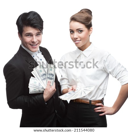 caucasian young smiling business people holding money isolated on white - stock photo