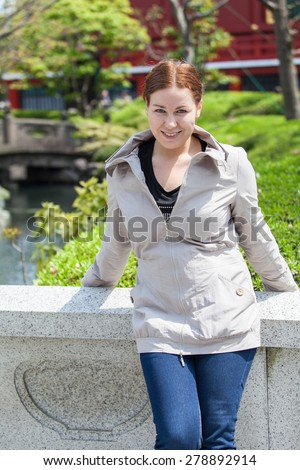 Caucasian young woman in japanese park. Summer portrait - stock photo