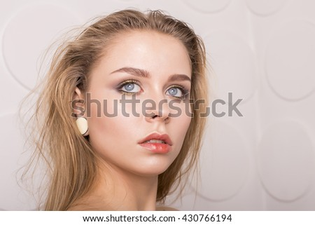 Caucasian young woman model with nude makeup with perfect clean skin