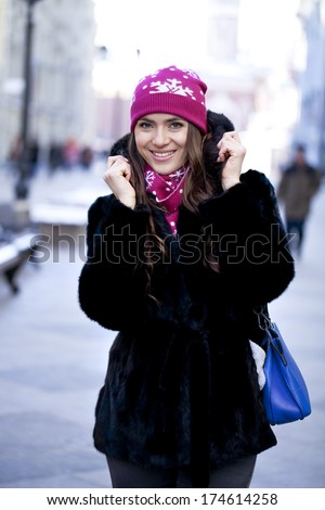 Caucasian young woman on a background of a winter city