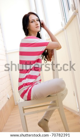 Caucasian young woman relaxing on the chair - stock photo