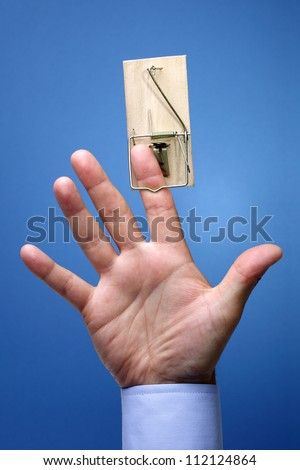 Caught in a mousetrap concept for temptation, corporate theft, danger or risk - stock photo