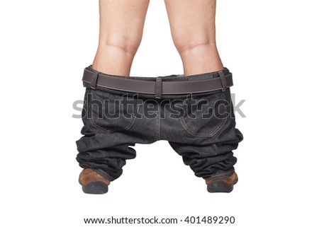 Caught with your pants down - man in brown shoes and jeans dropped down standing on floor, isolate on white background - stock photo