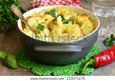Cauliflower baked in bechamel with cheese. - stock photo