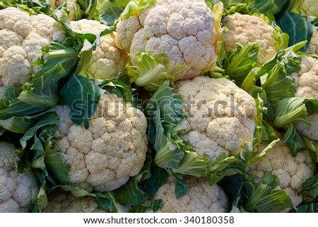 cauliflower cabbage texture pattern stacked in a row at market outdoor - stock photo