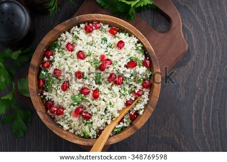 Cauliflower couscous with herbs and pomegranate, top view, horizontal - stock photo