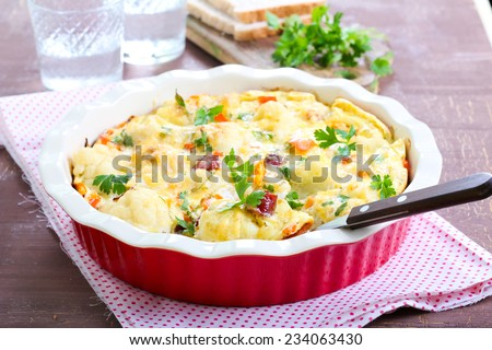Cauliflower savory cake with smoked sausages  - stock photo