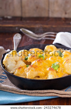 Cauliflower with cheese baked in cast iron pan - stock photo