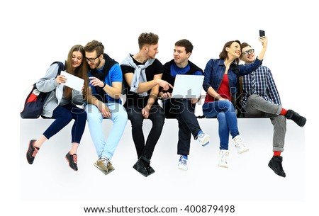 Causal group of people sitting on the floor isolated - stock photo