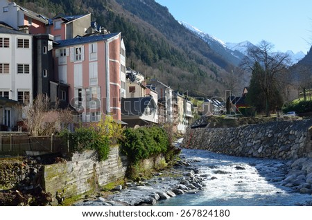 Cauterets is well known for its copious thermal springs. There are many small shops, hotels and comfy restaurants in the mountain town Cauterets on the steep slopes of Hautes-Pyrenees. - stock photo