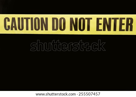 Caution Do Not Enter Tape with isolated background on black