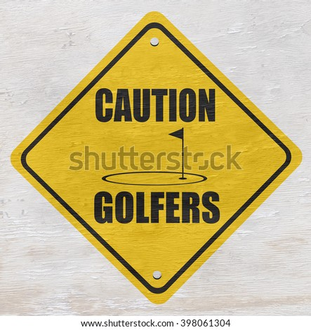 caution golfers sign on wood grain texture