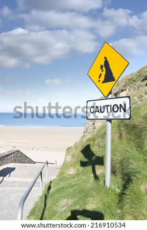 caution loose rocks or landslide sign in Ballybunion beach county Kerry Ireland's wild atlantic way  - stock photo