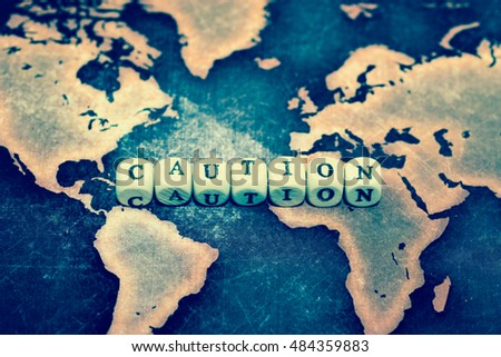 CAUTION on grunge world map