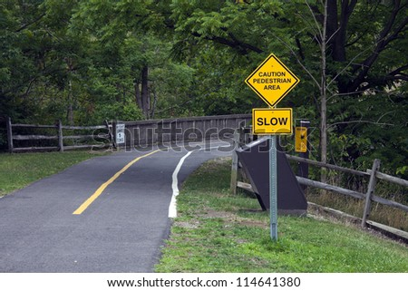 Caution - Pedestrian area. Sign for bikers in Cuyahoga Valley National Park. - stock photo