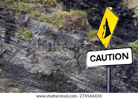 caution rock slide sign on Ballybunion beach in county Kerry Ireland - stock photo