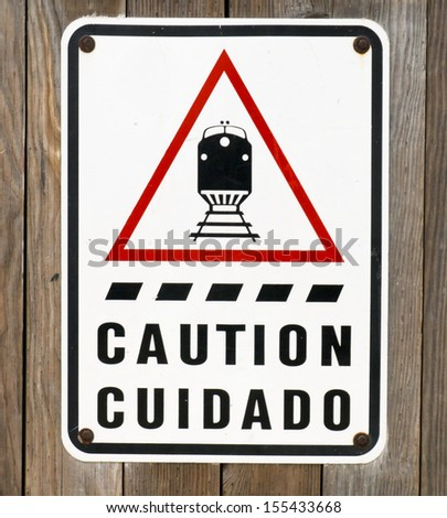 Caution sign for railroad crossing  - stock photo