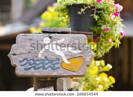 caution sign of falling into water at the lake - stock photo
