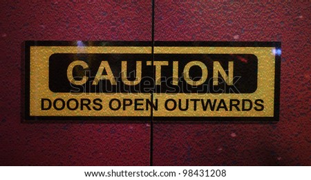 caution sign on door - stock photo