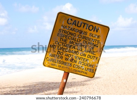 Caution sign on the North shore of Oahu, Hawaii - stock photo