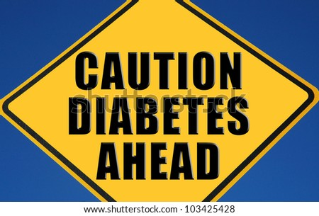 "Caution sign reading ""Caution Diabetes Ahead"" - stock photo"