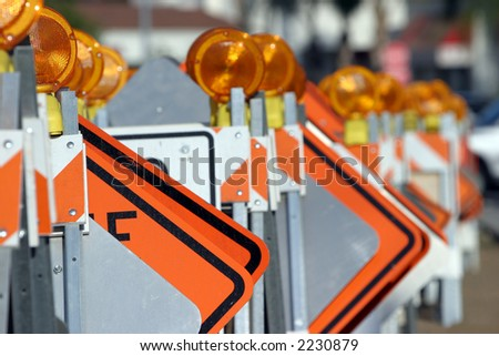 caution traffic signs, orange safety cones and amber warning lights - stock photo