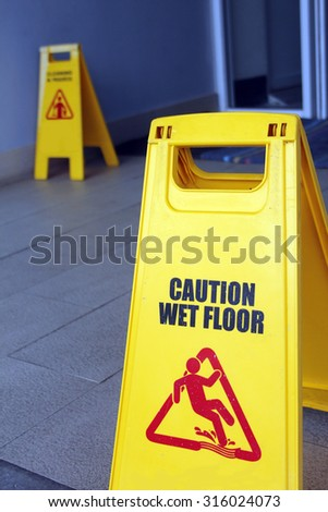 caution wet floor and cleaning in progress