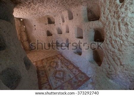 Cave dwelling and columbariums interior at the valley of Uchisar town. Cappadocia, Turkey. - stock photo