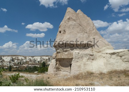 Cave house in Cappadocia, Turkey with blue sky and view to background - stock photo