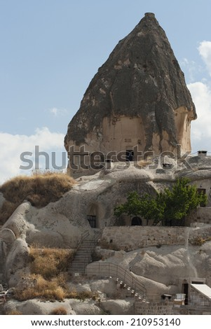 Cave house in Cappadocia, Turkey with vertical foreground - stock photo