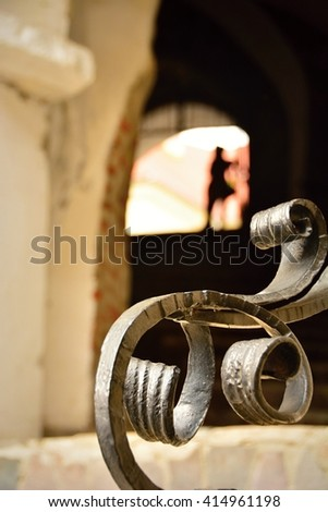 Cave in the castle and Wrought iron benches - stock photo