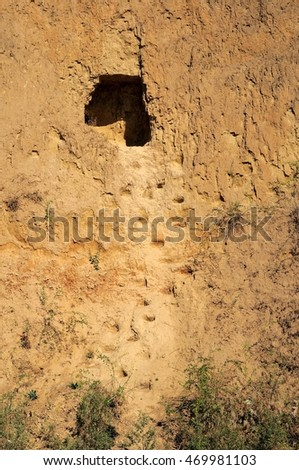cave in the cliff on the beach