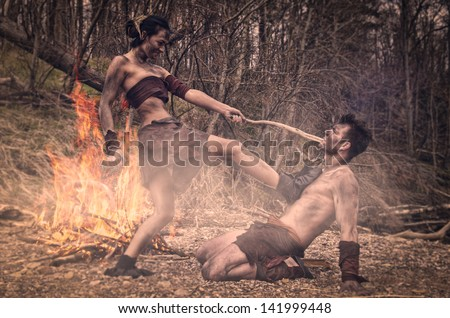 Cave man and cave woman  - stock photo