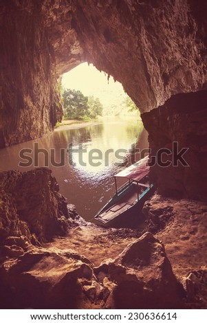 Cave on BaBe Lake in Vietnam - stock photo